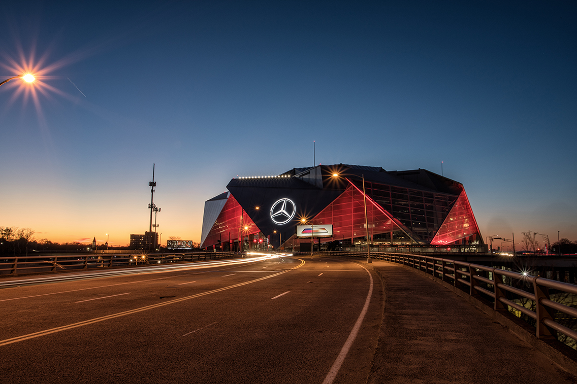 Sun setting on exterior of the Mercedes Benz Stadium, home of the NFL Atlanta Falcons